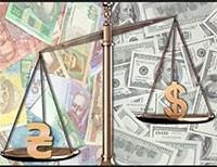 Национальная валюта на межбанке подешевела на гривню - до 23,3 за доллар