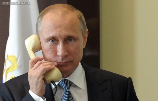 В Кремле рассказали, о чем вчера говорили Путин и Порошенко