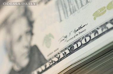 МВФ: Стоимость доллара завышена на 20%